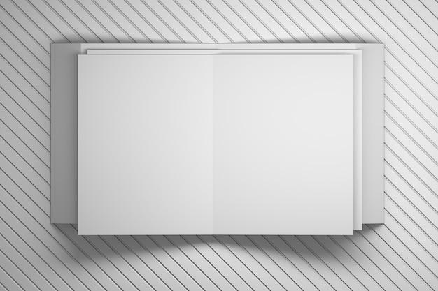 白い装飾的な縞模様の表面の上に敷設折り畳まれたホワイトペーパーパンフレットチラシシート。 Premium写真