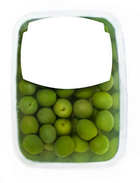 プラスチックボックス表面のオリーブ Premium写真