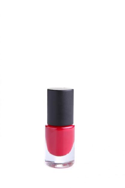 白で隔離される赤いマニキュアボトル Premium写真