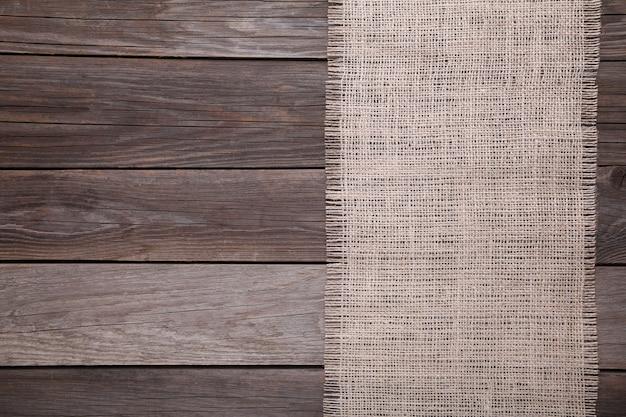 灰色の木製の自然な荒布、灰色の木製テーブルのキャンバス Premium写真