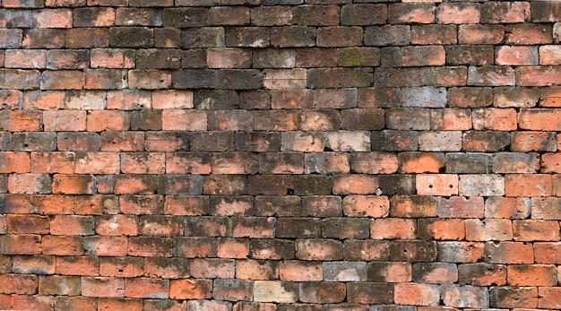 レンガ壁の背景古いレンガの石積みの質感 Premium写真