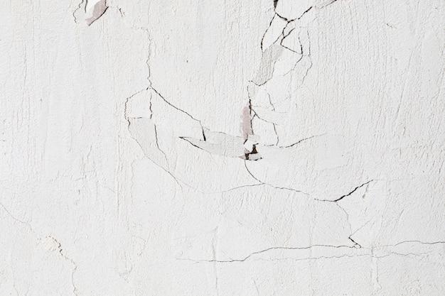 Трещины стены текстуры фона Premium Фотографии