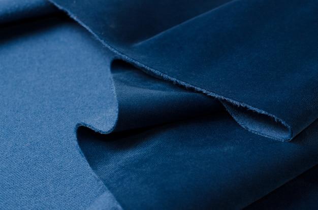明るい青のベロア繊維サンプル。生地のテクスチャ Premium写真