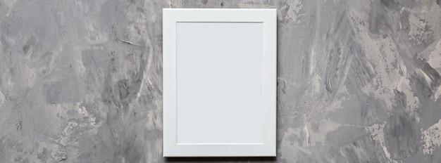 灰色のコンクリート背景に空白のフォトフレーム Premium写真