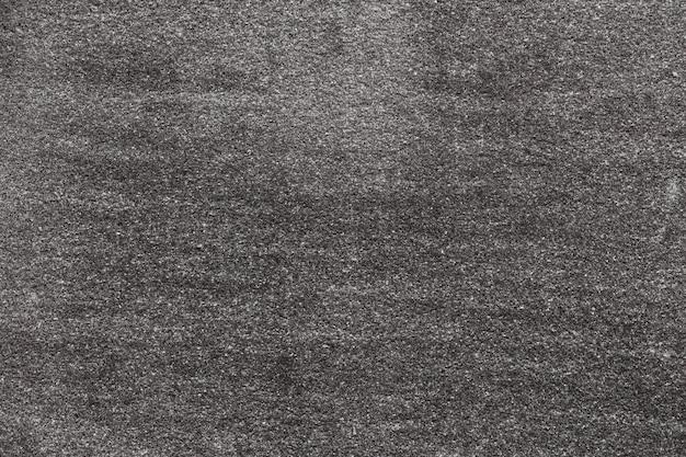 Асфальт с мелкозернистой текстурой. крупным планом фото Premium Фотографии