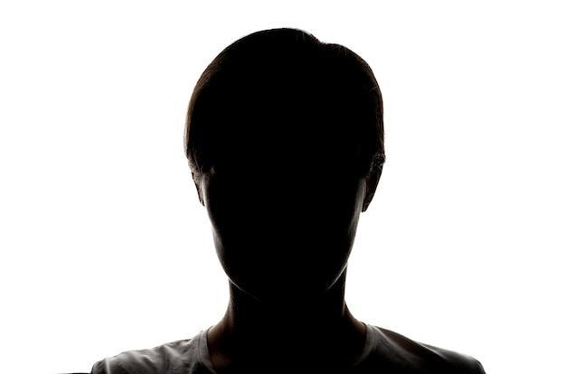 匿名の概念、白い背景の上の若い女の子の暗いシルエット Premium写真