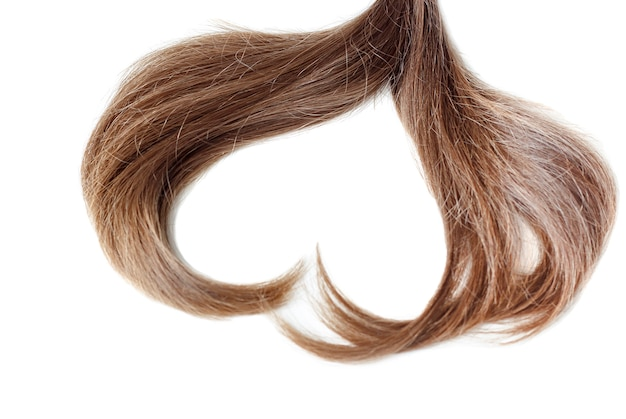 Прядь светло-каштановых волос в форме сердца крупным планом Premium Фотографии