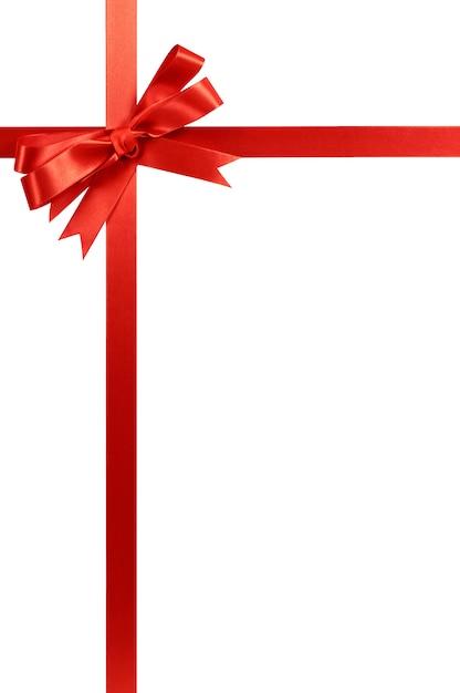 赤いリボンと弓は白く孤立しています。 無料写真