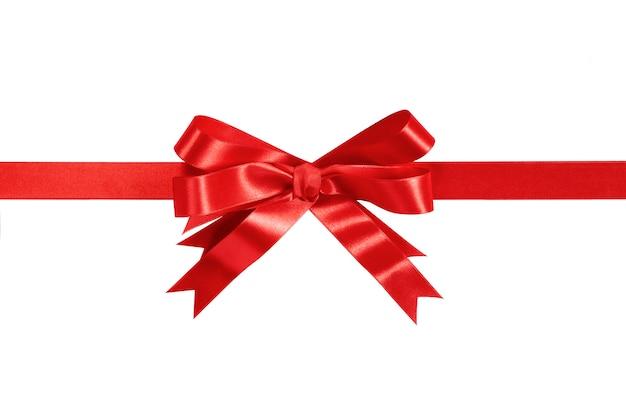 赤いギフトのリボンと弓は、白いにしてください。 無料写真