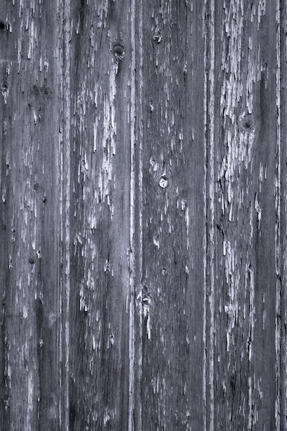 古い剥離塗料の木製パネルの背景の垂直 Premium写真