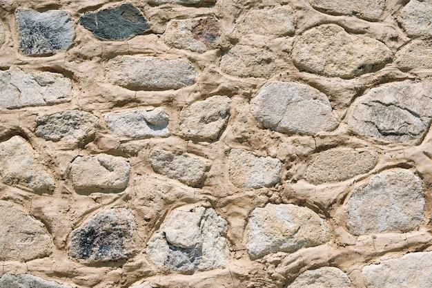 古い石造りの壁の背景テクスチャのクローズアップ 無料写真