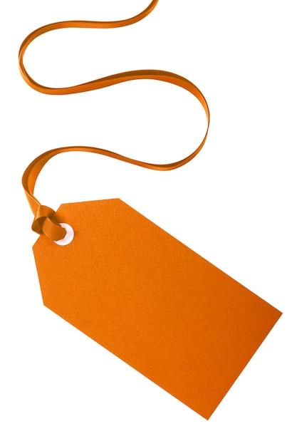 白で隔離巻きリボンと結ばれるプレーンマニララベル Premium写真