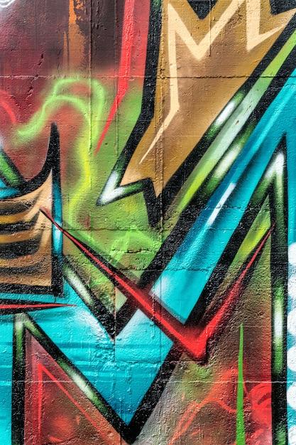 Уличное искусство, разноцветные граффити на стене Premium Фотографии