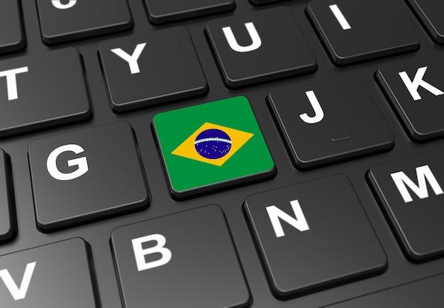 黒いキーボードにブラジルの国旗を持つボタンのクローズアップ Premium写真