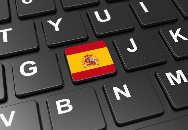 黒いキーボードにスペイン国旗の付いたボタンのクローズアップ Premium写真
