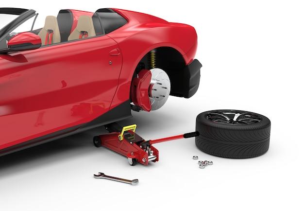 Автомобиль поднят с красным гидравлическим домкратом для ремонта Premium Фотографии