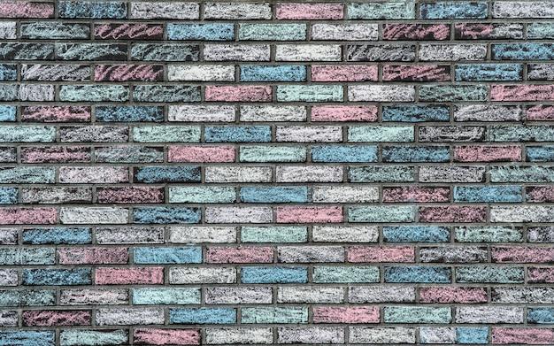 レンガの壁のカラフルなテクスチャ Premium写真