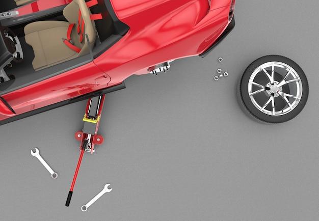 Вид сверху на автомобиль, поднятый с красным гидравлическим домкратом Premium Фотографии