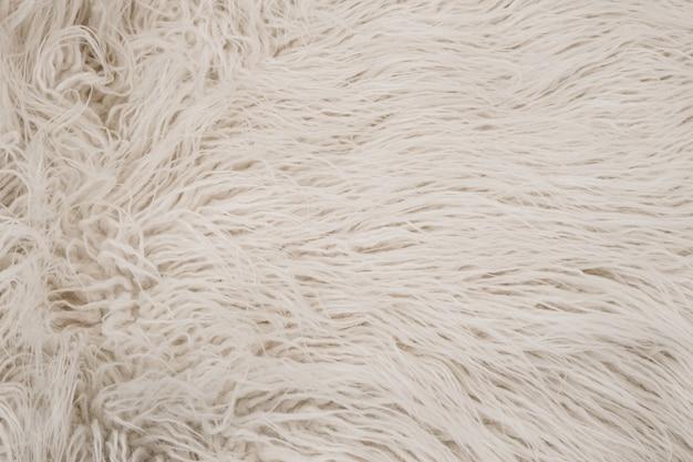 白シャギー毛皮の質感。 Premium写真
