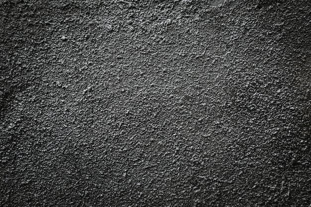 Черный асфальт зернистая стена. Premium Фотографии