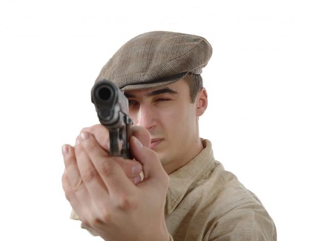 Французский гангстер с огнестрельным оружием, на белом Premium Фотографии