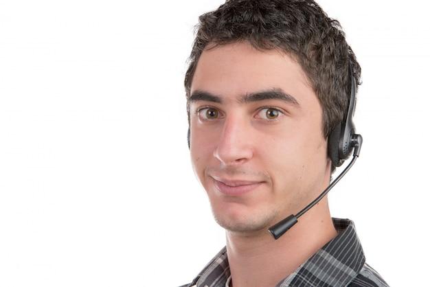 Молодой человек работает на горячей линии Premium Фотографии