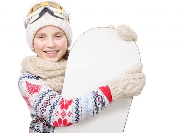 スノーボードでかなり若い女の子 Premium写真