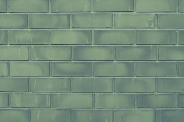 Зеленый старый конец-вверх кирпичной стены с шить. текстура каменной кладки. кирпичный фон для съемки предмета плоской планировки. концепция строительства и дизайна интерьера. копировать пространство Premium Фотографии