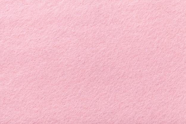 ライトピンクのマットスエード生地のフェルトのベルベットの質感、 Premium写真