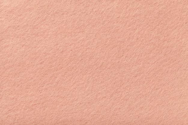 ライトピンクのマットスエード生地のクローズアップ Premium写真