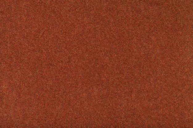 ダークオレンジマットスエード生地のクローズアップ Premium写真