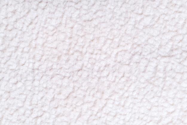 柔らかく、フリースの布の白いふわふわの背景 Premium写真