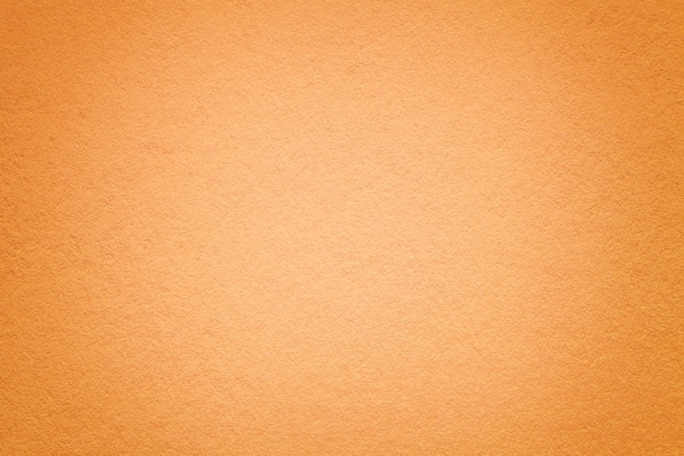 Текстура старой оранжевой бумажной предпосылки, крупного плана. Premium Фотографии