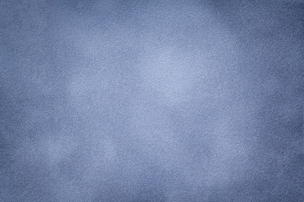 水色のスエード生地のクローズアップの背景。 Premium写真