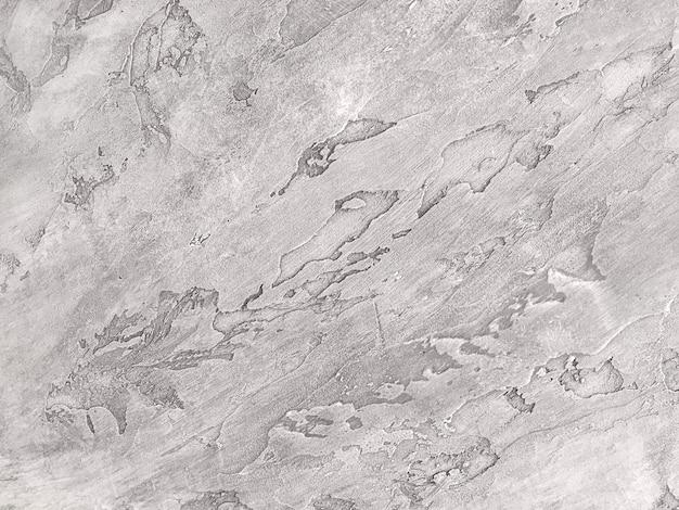 古い剥離壁を模倣したテクスチャ装飾的な灰色プラスター。 Premium写真