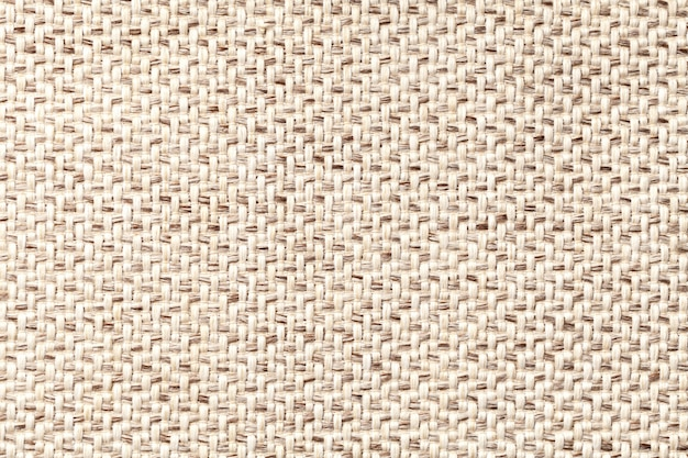 織りのテクスチャのクローズアップとベージュのビンテージ生地。繊維マクロの背景 Premium写真