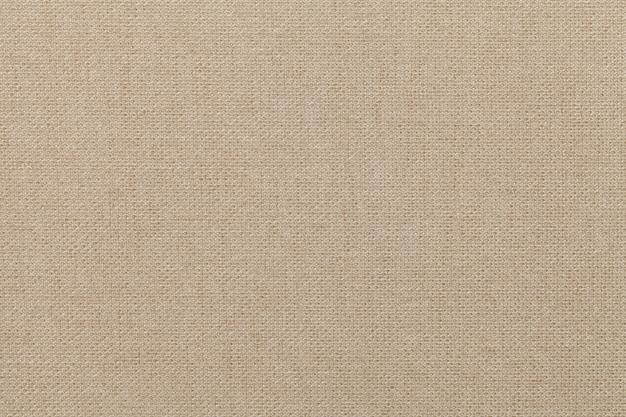 Светло-бежевый фон из текстильного материала, ткань с натуральной текстурой, Premium Фотографии