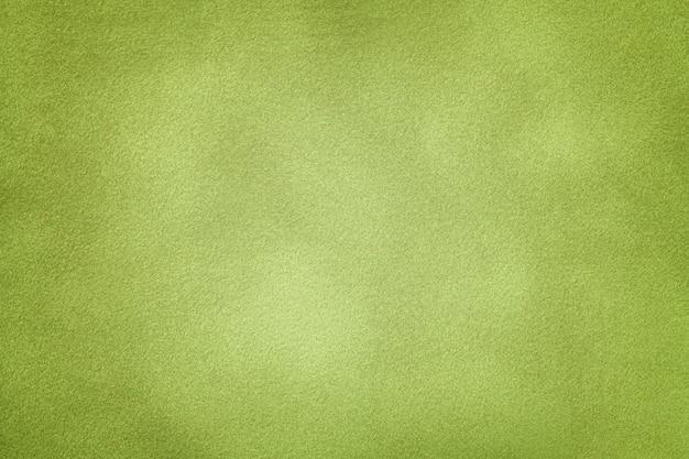 ライトグリーンのスエード生地のクローズアップの背景。 Premium写真