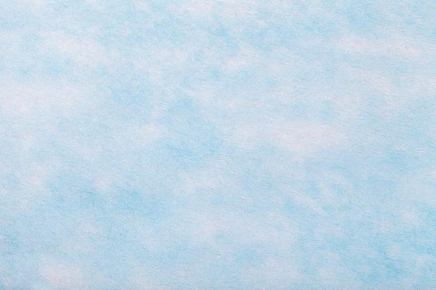 フェルト生地の明るい青の背景。 Premium写真