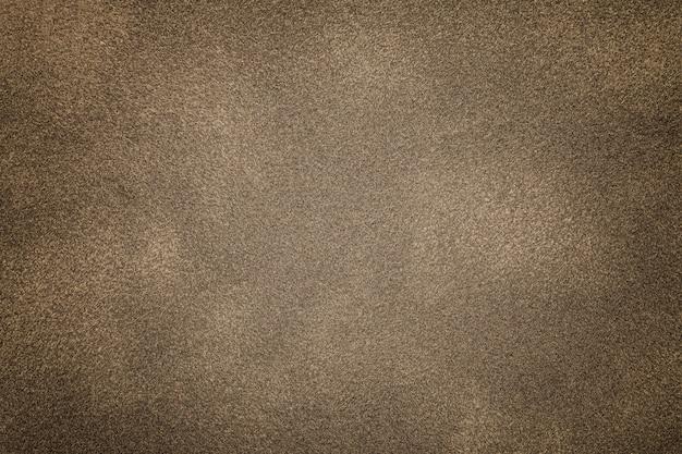 ライトブロンズスエード生地の背景 Premium写真