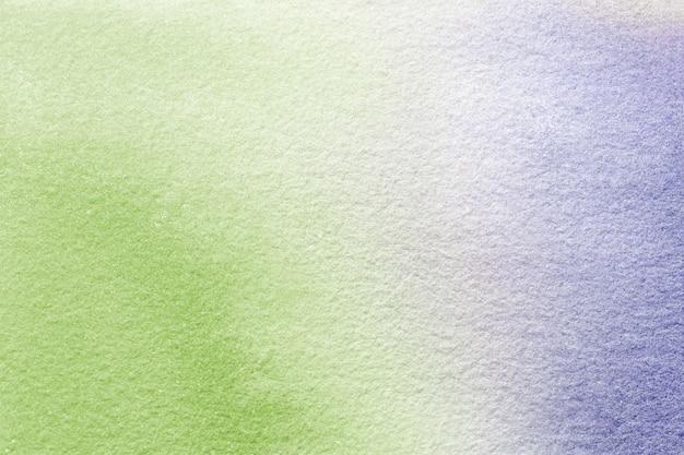 抽象芸術の背景の明るい緑と紫の色。キャンバスに水彩画。 Premium写真