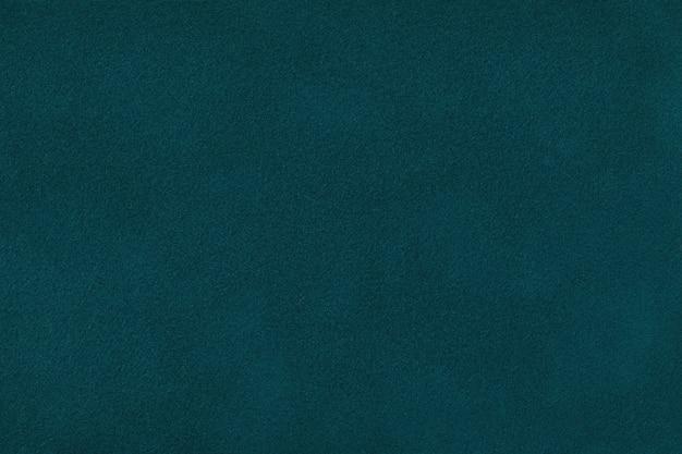 ダークグリーンマットスエード生地のクローズアップ。ベルベットのテクスチャ背景。 Premium写真
