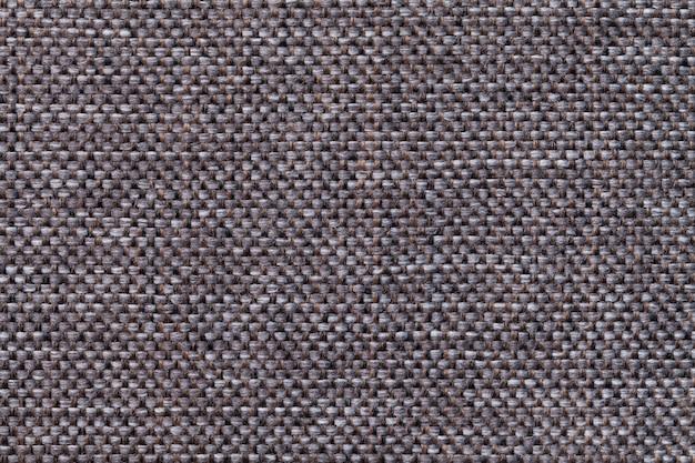 Крупный план предпосылки ткани темного коричневого цвета. структура ткани макроса Premium Фотографии