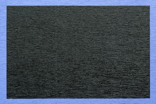 青いフレームに囲まれた木製の黒い背景。 Premium写真