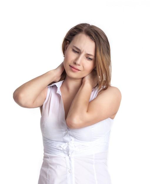 美しい若い女性は首の痛みを経験しています Premium写真