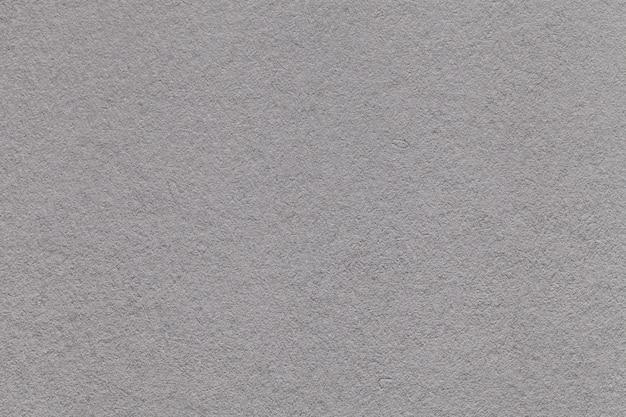 古いライトグレーの紙のクローズアップの質感 Premium写真