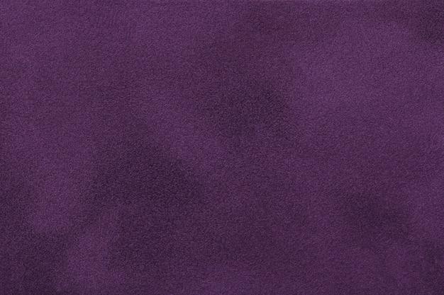 ダークパープルマットスエード生地。ビロードのテクスチャ背景 Premium写真