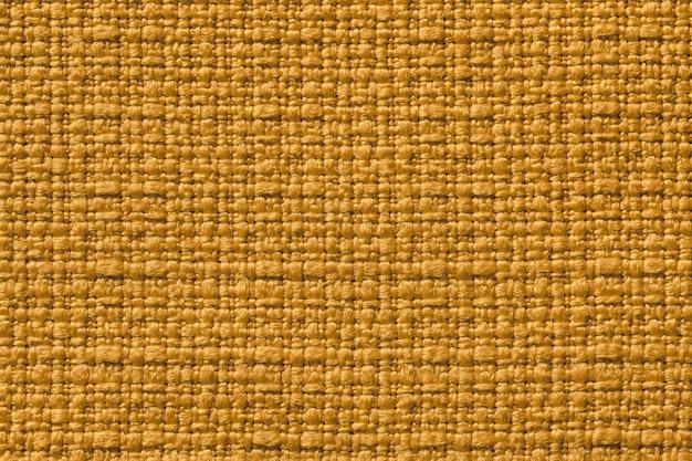 繊維材料からの濃い黄色の背景 Premium写真