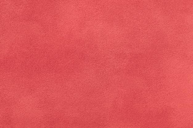 ダークレッドのマットスエード生地のクローズアップ Premium写真