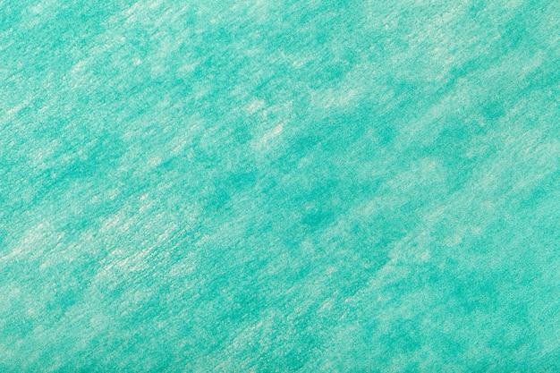 フェルト生地の明るいターコイズブルーの背景 Premium写真